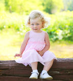 Portrait little girl child wearing a pink dress in spring Royalty Free Stock Image