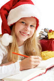 Portrait of little girl with Christmas gifts on the white backgr Royalty Free Stock Photography