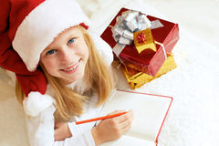 Portrait of little girl with Christmas gifts on the white backgr Stock Images