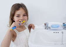Portrait of a little girl cleaning her teeth Royalty Free Stock Photo