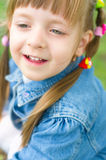 Portrait of a little girl. Closeup summer portrait of a happy little girl outdoors Royalty Free Stock Photos
