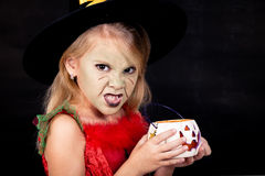 Portrait of little girl in costume witch on Halloween Royalty Free Stock Images