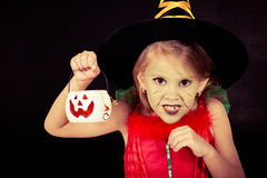 Portrait of little girl in costume witch on Halloween Royalty Free Stock Photography