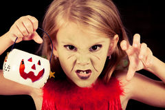 Portrait of little girl in costume witch on Halloween Stock Photography