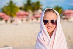 Portrait of little girl covered with towel at Stock Photography