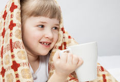 Portrait of a little girl covering with a rug Royalty Free Stock Images