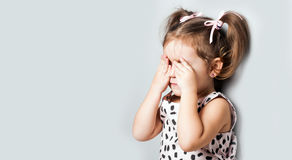Portrait of a little girl. She is crying and hurt royalty free stock images