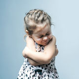 Portrait of a little girl. She is crying and hurt stock images
