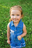 Portrait of little girl with dandelion Stock Image