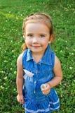 Portrait of little girl with dandelion. Portrait of cute little girl with dandelion Stock Image
