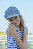 Portrait of little girl in denim cap outdoors Royalty Free Stock Photos