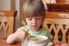Portrait of little girl during a dinner Stock Photography
