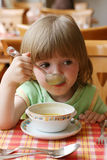 Portrait of little girl during  dinner Stock Images