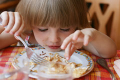 Portrait of little girl during  dinner. Portrait of the charming little girl during a dinner Stock Image