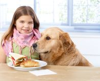 Portrait of little girl and dog smiling Royalty Free Stock Photo