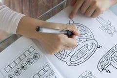 Portrait of little girl doing homework stock photos