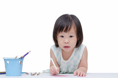 Portrait of a little girl drawing a sketch. Portrait of a little Asian girl drawing a sketch over white stock image