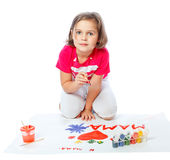 Portrait of a little girl draws Royalty Free Stock Images