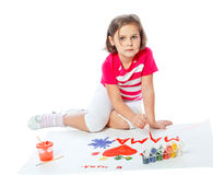 Portrait of a little girl draws Royalty Free Stock Photo