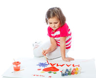 Portrait of a little girl draws Royalty Free Stock Photos