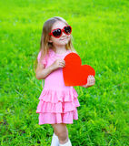 Portrait of little girl in dress, sunglasses with red heart Stock Image