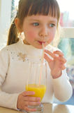 Portrait of  little girl drinking juice Stock Images