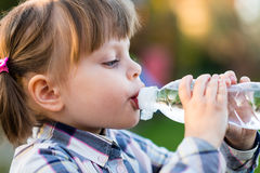 Portrait of little girl drinking water outdoor Royalty Free Stock Photography