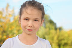 Portrait of little girl in early fall park Royalty Free Stock Photography
