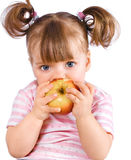 Portrait of a little girl eating an apple Stock Photography