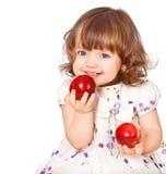 Portrait of a little girl eating apples Stock Image