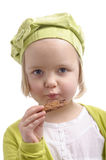 Portrait of little girl eating a cookie Royalty Free Stock Photos
