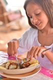 Girl eating meat pockets Royalty Free Stock Photo