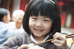 Portrait of little girl eating rice Royalty Free Stock Image