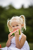 Portrait of a little girl eating watermelon Royalty Free Stock Image