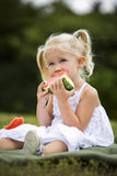 Portrait of a little girl eating watermelon Stock Photo