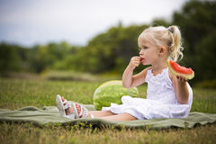Portrait of a little girl eating watermelon Royalty Free Stock Photo
