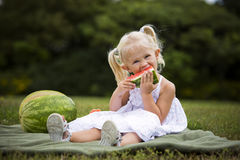 Portrait of a little girl eating watermelon Royalty Free Stock Photos