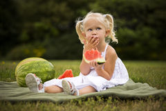 Portrait of a little girl eating watermelon Stock Photography