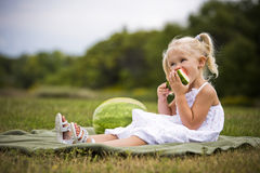 Portrait of a little girl eating watermelon Royalty Free Stock Photography