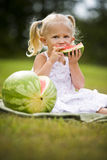 Portrait of a little girl eating watermelon Stock Photos