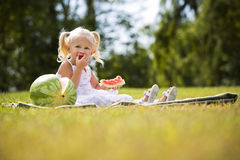 Portrait of a little girl eating watermelon Stock Images