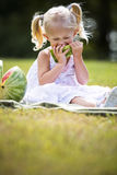 Portrait of a little girl eating watermelon Stock Image