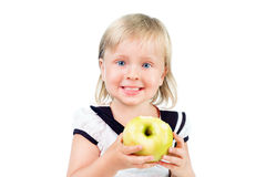 Portrait of little girl eating yellow apple Royalty Free Stock Image