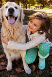 Portrait of little girl embracing her dog Stock Photo