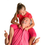 Portrait of a little girl enjoying piggyback ride with her grand Stock Photography