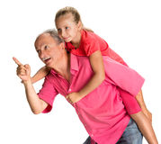 Portrait of a little girl enjoying piggyback ride with her grand Royalty Free Stock Image