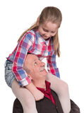 Portrait of a little girl enjoying piggyback ride with her grand. Father on a white background Royalty Free Stock Images
