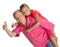 Portrait of a little girl enjoying piggyback ride with her grand Stock Photos