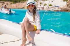 Portrait of little girl enjoying sailing on big Stock Photography