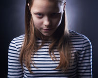 Portrait of a little girl with evil face Royalty Free Stock Images